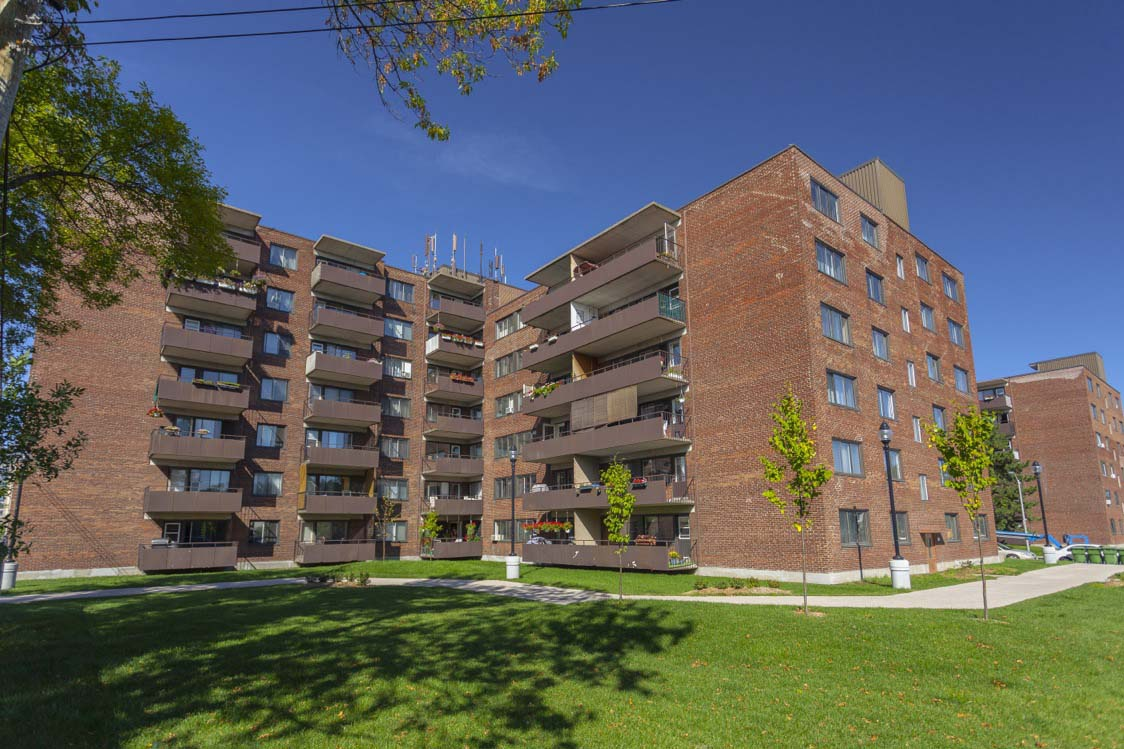 Not Sure for rent at 455 Racine Avenue, Dorval, QC. This is the outdoor building with lawn.