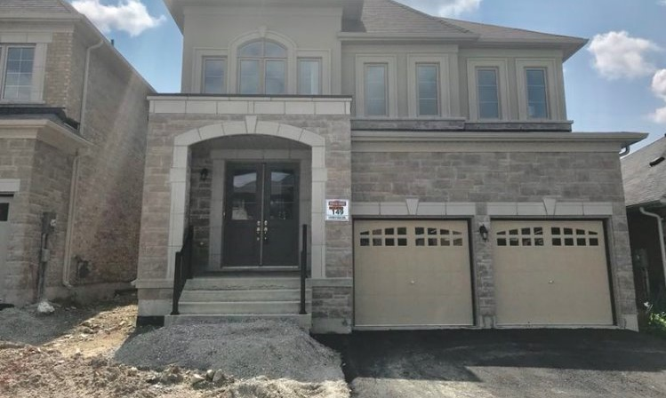 House for rent at 6 Forest Edge Crescent, East Gwillimbury, ON in mediterranean  spanish style. This is the front of the house with french doors.