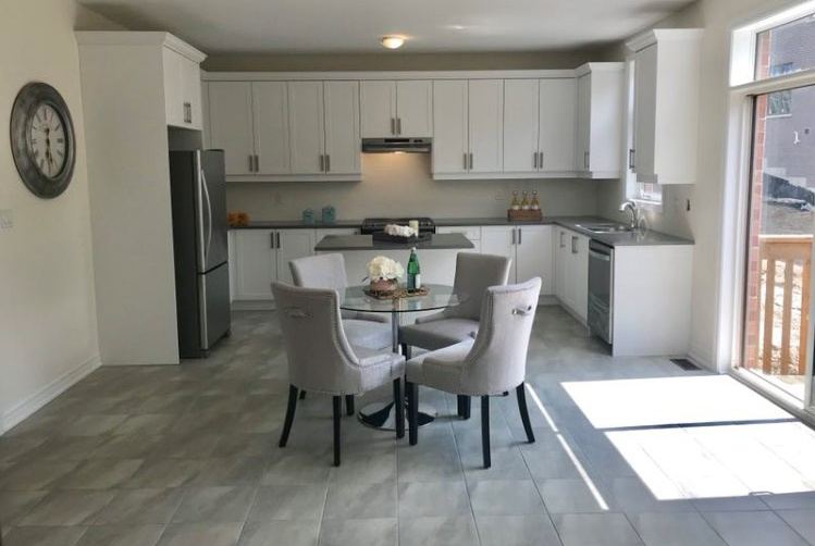 House for rent at 6 Forest Edge Crescent, East Gwillimbury, ON. This is the kitchen with natural light, stainless steel and tile floor.