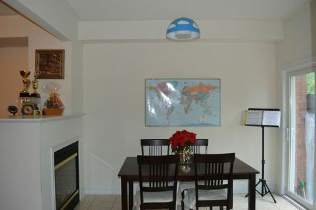 House for rent at 30 Triburnham Pl, Etobicoke, ON. This is the dining area with tile floor, fireplace and natural light.