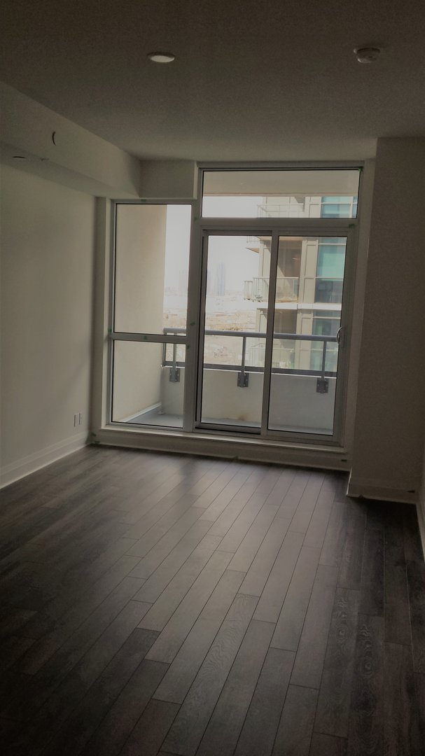 Condo for rent at 17 Zorra St | Unit: 1001, Etobicoke, ON. This is the empty room with hardwood floor and natural light.