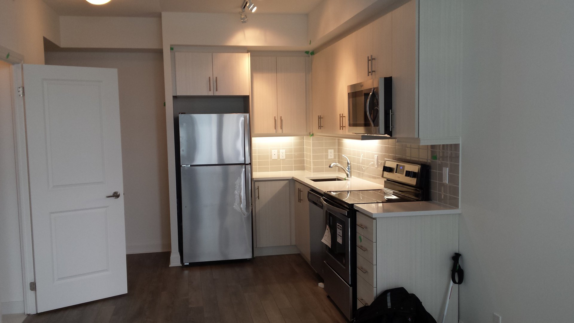 Condo for rent at 17 Zorra St | Unit: 1001, Etobicoke, ON. This is the kitchen with hardwood floor and stainless steel.