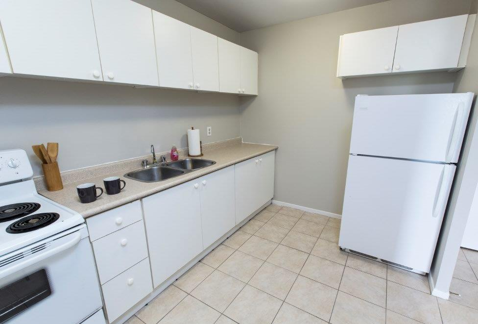 Apartment for rent at 7170, 7230, 7280 Darcel Ave, Etobicoke, ON. This is the kitchen with tile floor.