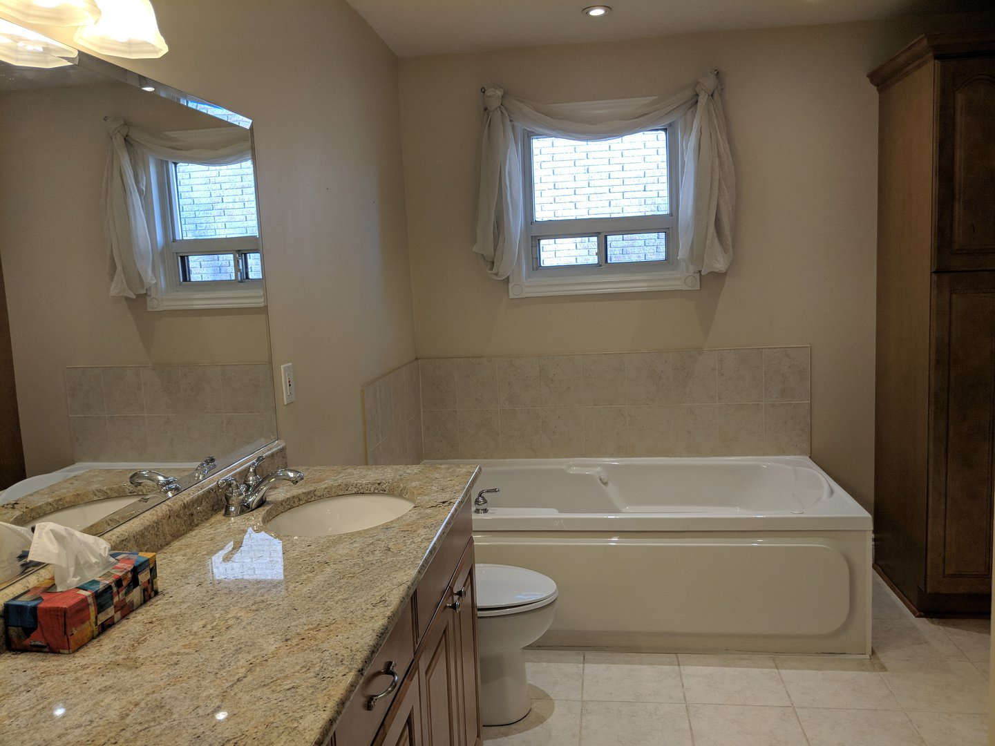 House for rent at 1162 Kipling Ave | Unit: upper, Etobicoke, ON. This is the bathroom with vaulted ceiling, tile floor and natural light.
