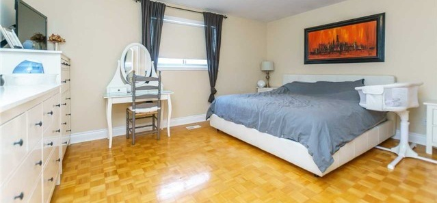 House for rent at 1162 Kipling Ave | Unit: upper, Etobicoke, ON. This is the bedroom with hardwood floor and natural light.