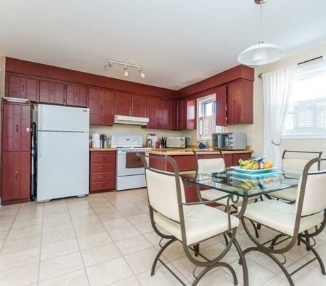 House for rent at 1162 Kipling Ave | Unit: upper, Etobicoke, ON. This is the kitchen with tile floor and natural light.