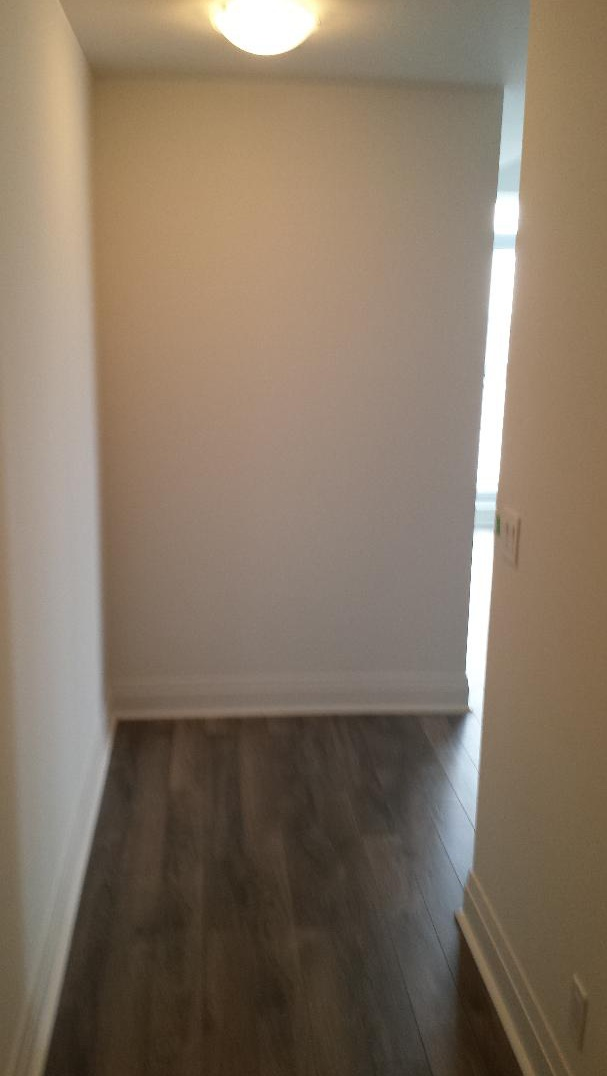 Condo for rent at 17 Zorra St | Unit: Varies, Etobicoke, ON. This is the empty room with hardwood floor.