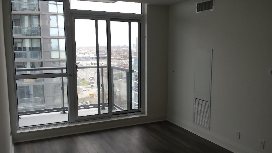 Condo for rent at 17 Zorra St | Unit: Varies, Etobicoke, ON. This is the empty room with natural light and hardwood floor.