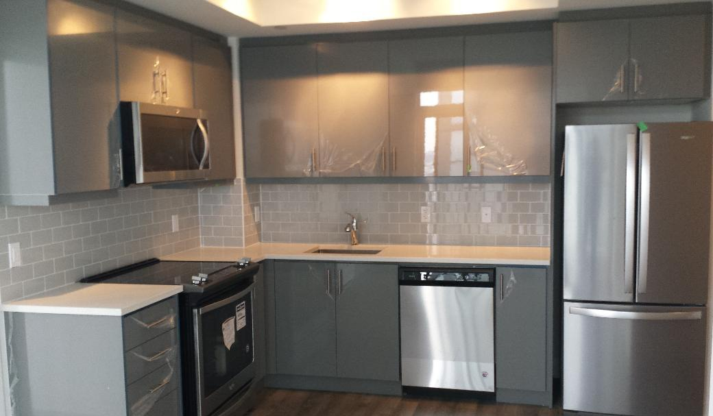 Condo for rent at 17 Zorra St | Unit: Varies, Etobicoke, ON. This is the kitchen with stainless steel and hardwood floor.