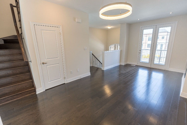 House for rent at 1040 Islington Ave, Etobicoke, ON. This is the empty room with hardwood floor, french doors and natural light.
