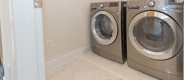 House for rent at 1040 Islington Ave, Etobicoke, ON. This is the laundry room with tile floor.