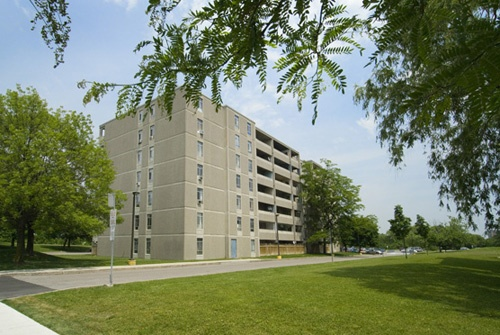 Apartment for rent at 1915 Martin Grove Road, Etobicoke, ON. This is the outdoor building with lawn.