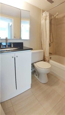 Condo for rent at 370 Dixon Rd, Etobicoke, ON. This is the bathroom with tile floor.