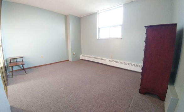 Condo for rent at 370 Dixon Rd, Etobicoke, ON. This is the empty room with carpet and natural light.