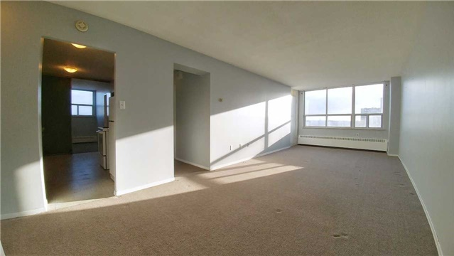 Condo for rent at 370 Dixon Rd, Etobicoke, ON. This is the empty room with carpet, natural light and tile floor.