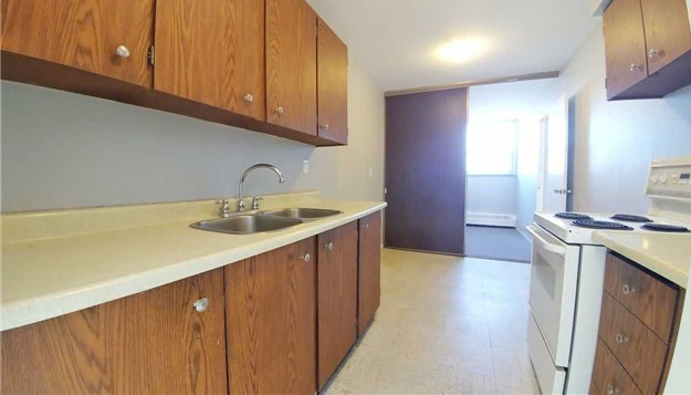 Condo for rent at 370 Dixon Rd, Etobicoke, ON. This is the kitchen with tile floor.