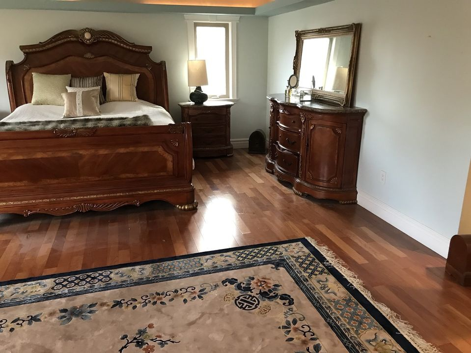 House for rent at 23 Walnut Crescent, Etobicoke, ON. This is the bedroom with hardwood floor and natural light.