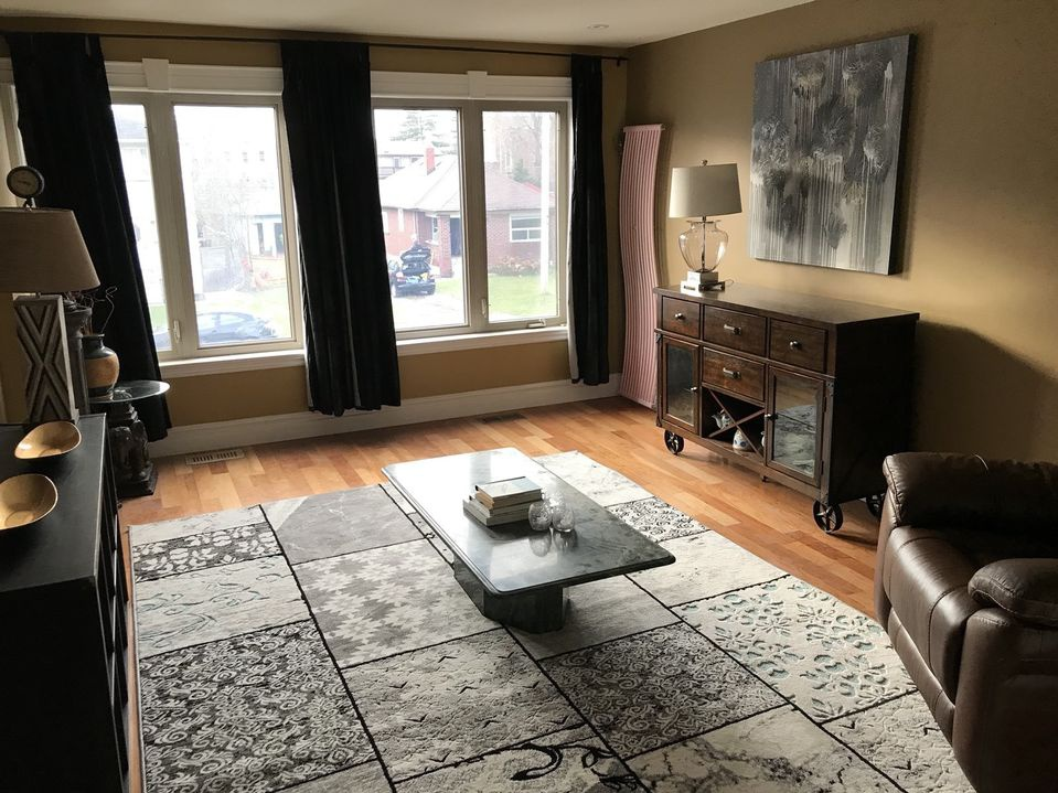 House for rent at 23 Walnut Crescent, Etobicoke, ON. This is the living room with hardwood floor and natural light.