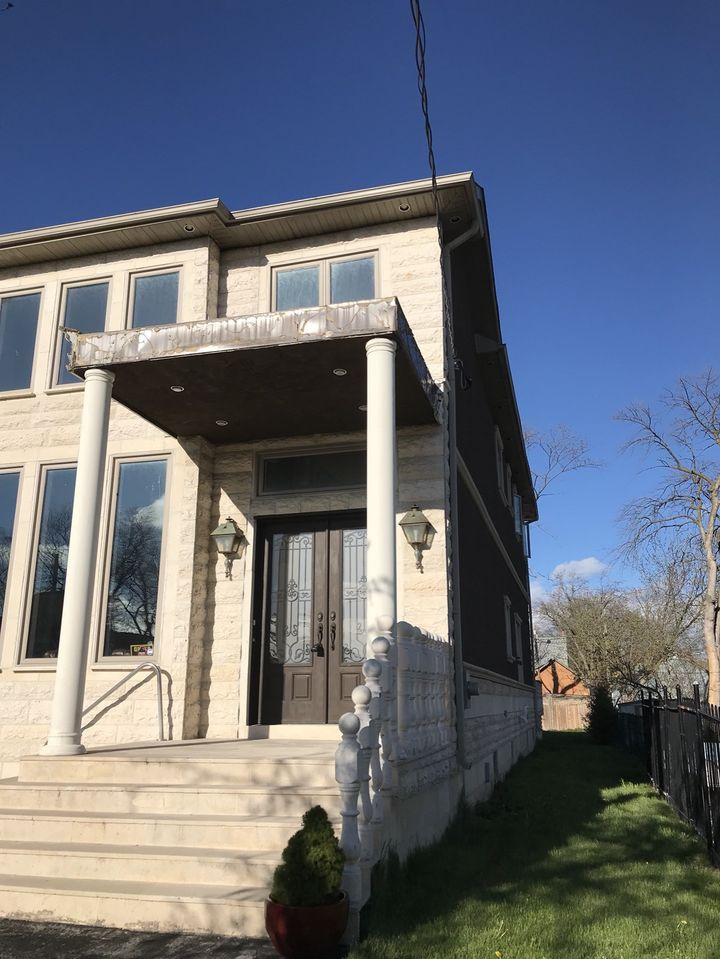 House for rent at 23 Walnut Crescent, Etobicoke, ON. This is the outdoor building with lawn and french doors.