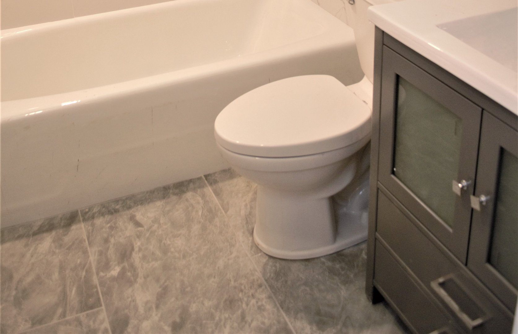 House for rent at 20 Sixth St, Etobicoke, ON. This is the bathroom with tile floor.