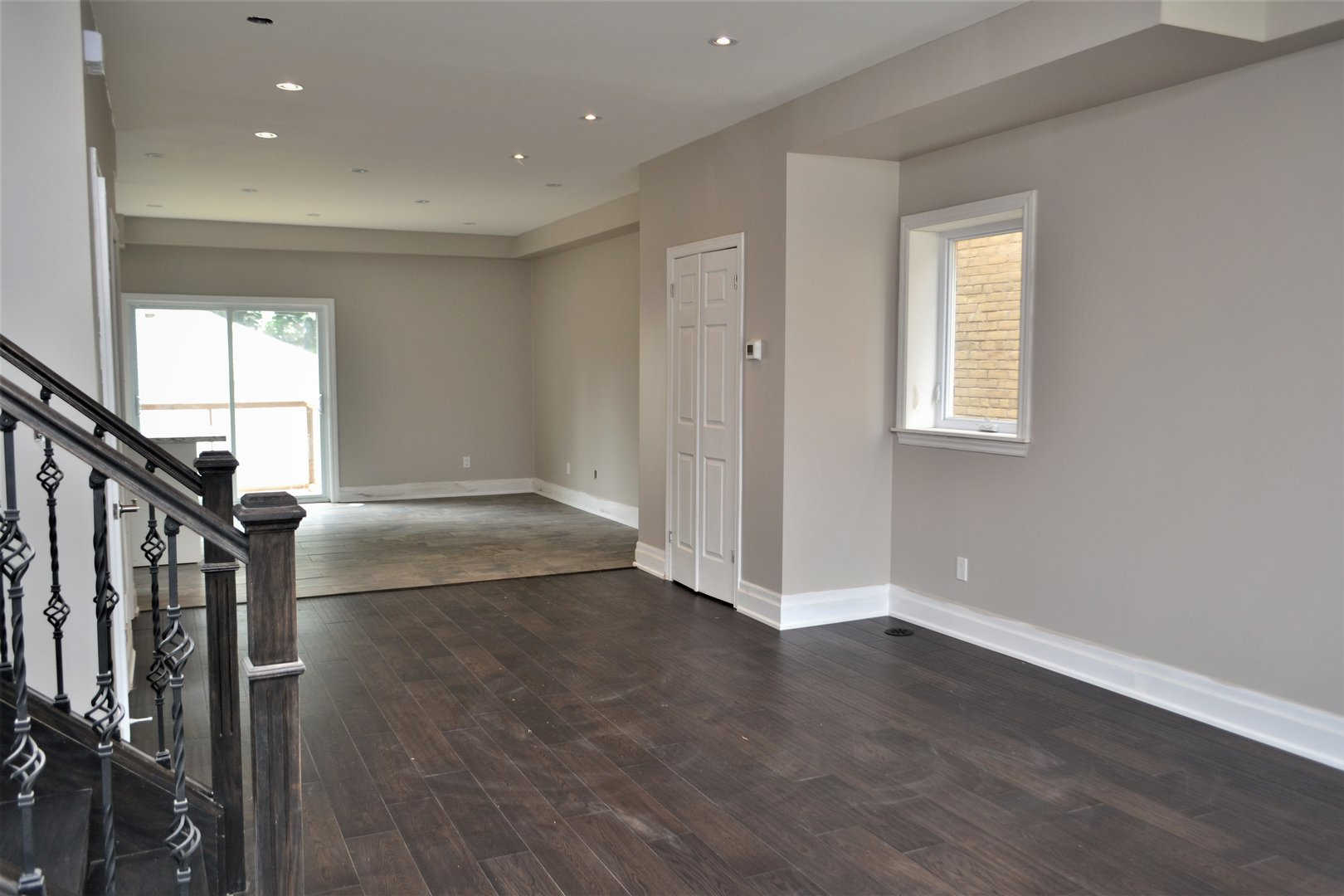 House for rent at 20 Sixth St, Etobicoke, ON. This is the empty room with natural light, carpet and hardwood floor.