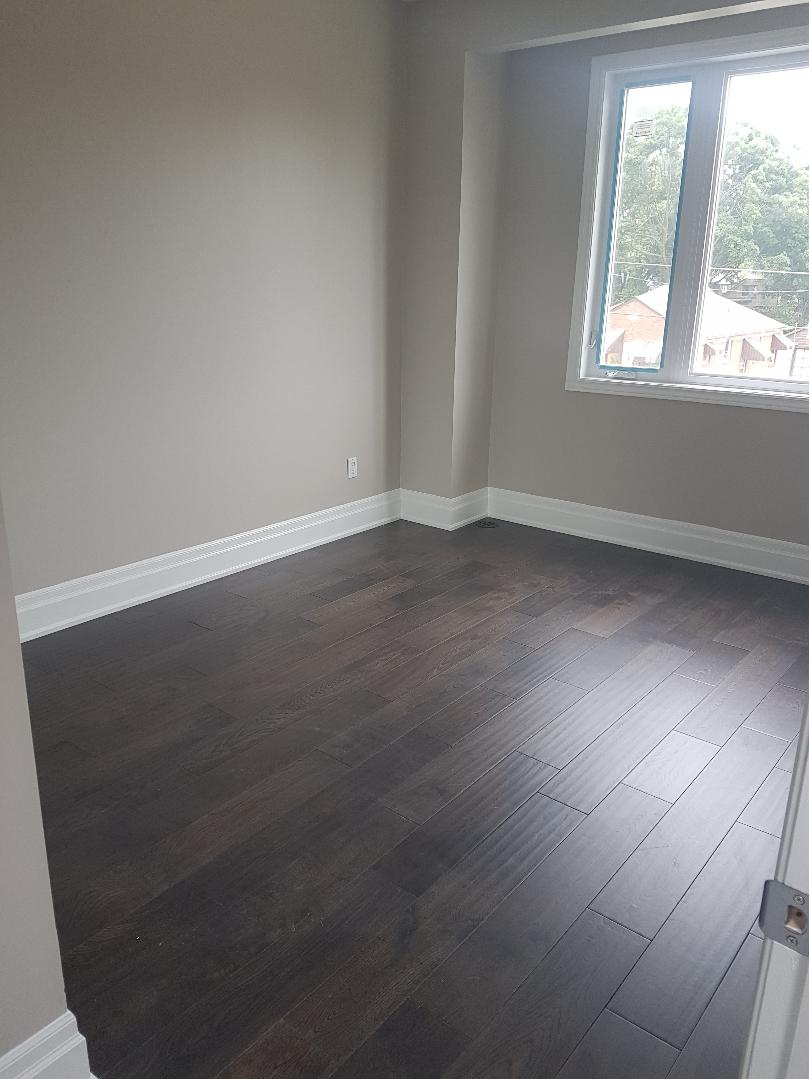 House for rent at 20 Sixth St, Etobicoke, ON. This is the empty room with natural light and hardwood floor.