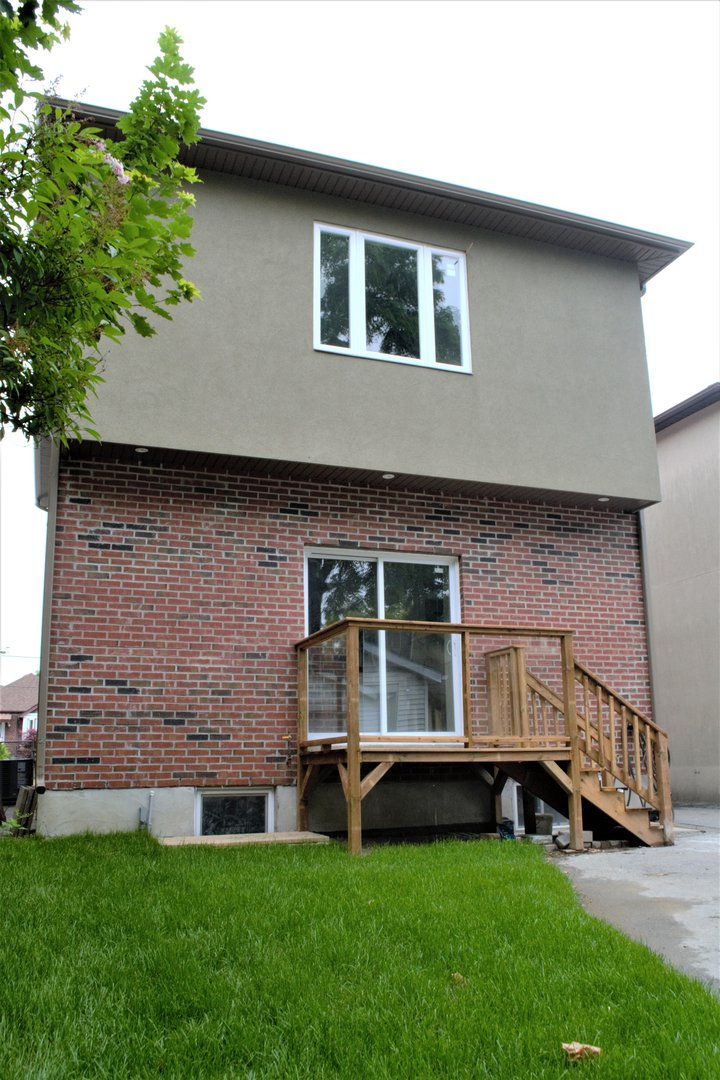 House for rent at 20 Sixth St, Etobicoke, ON in ranch style. This is the front of the house with lawn.