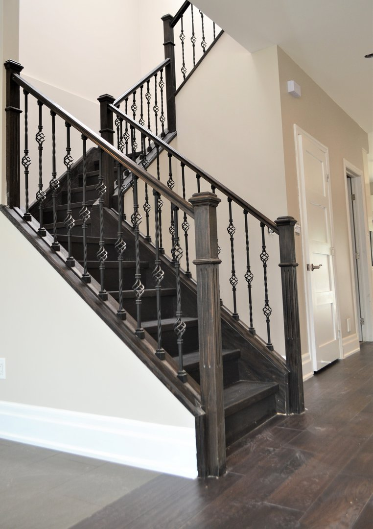 House for rent at 20 Sixth St, Etobicoke, ON. This is the stairs with hardwood floor and high ceiling.