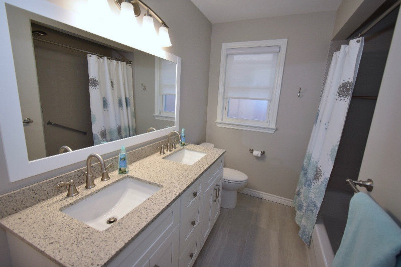 House for rent at 18 Pagebrook Dr, Etobicoke, ON. This is the bathroom with hardwood floor and natural light.