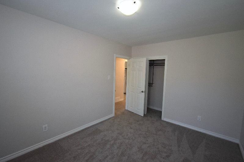 House for rent at 18 Pagebrook Dr, Etobicoke, ON. This is the empty room with carpet.
