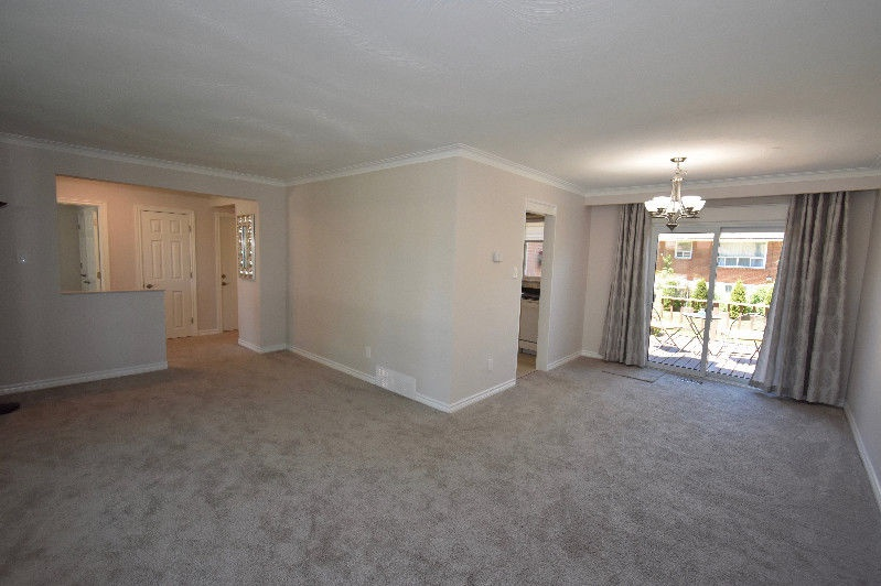 House for rent at 18 Pagebrook Dr, Etobicoke, ON. This is the empty room with natural light and carpet.
