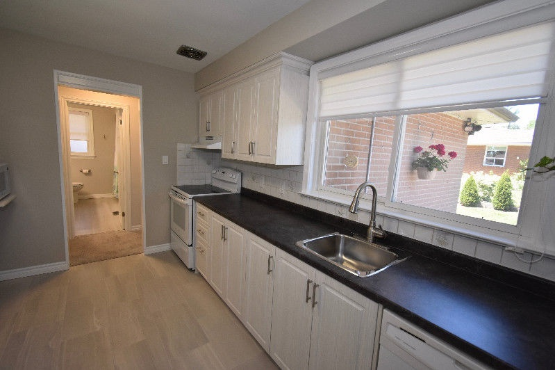 House for rent at 18 Pagebrook Dr, Etobicoke, ON. This is the kitchen with hardwood floor and natural light.