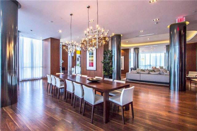 Condo for rent at 9 Valhalla Inn Road, Etobicoke, ON. This is the dining area with kitchen bar, hardwood floor, notable chandelier and natural light.