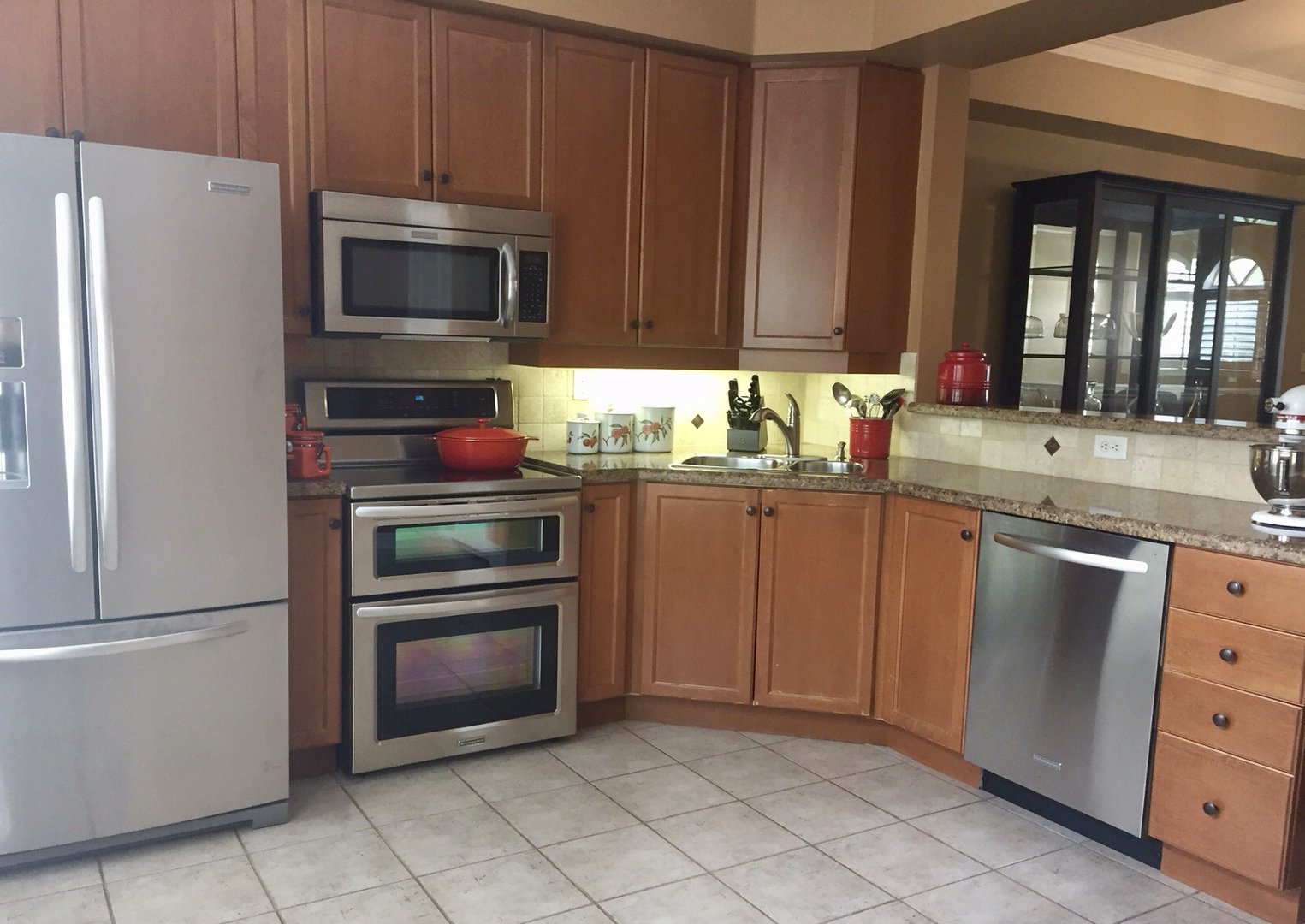 House for rent at 60 Superior Creek Ln, Etobicoke, ON. This is the kitchen with stainless steel and tile floor.