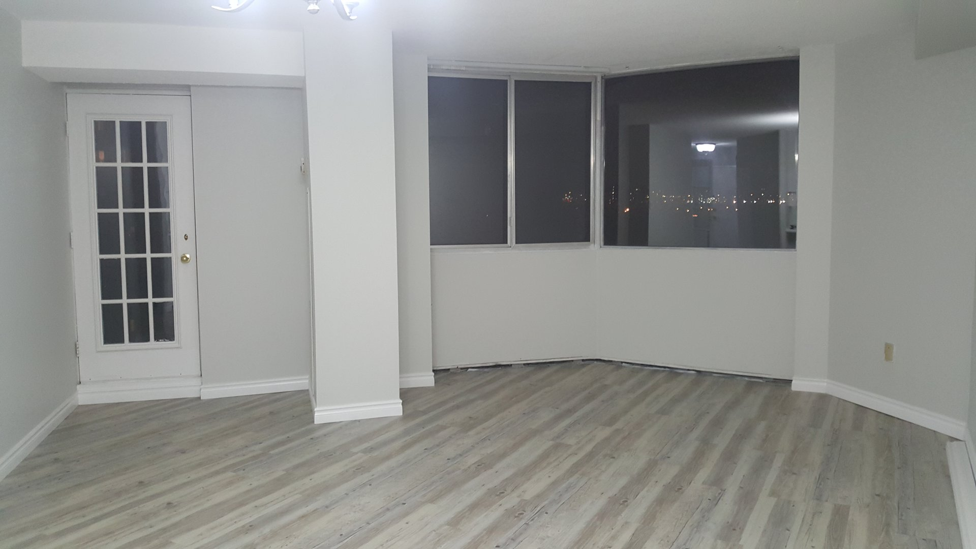 Condo for rent at 236 Albion Road, Etobicoke, ON. This is the empty room with hardwood floor.