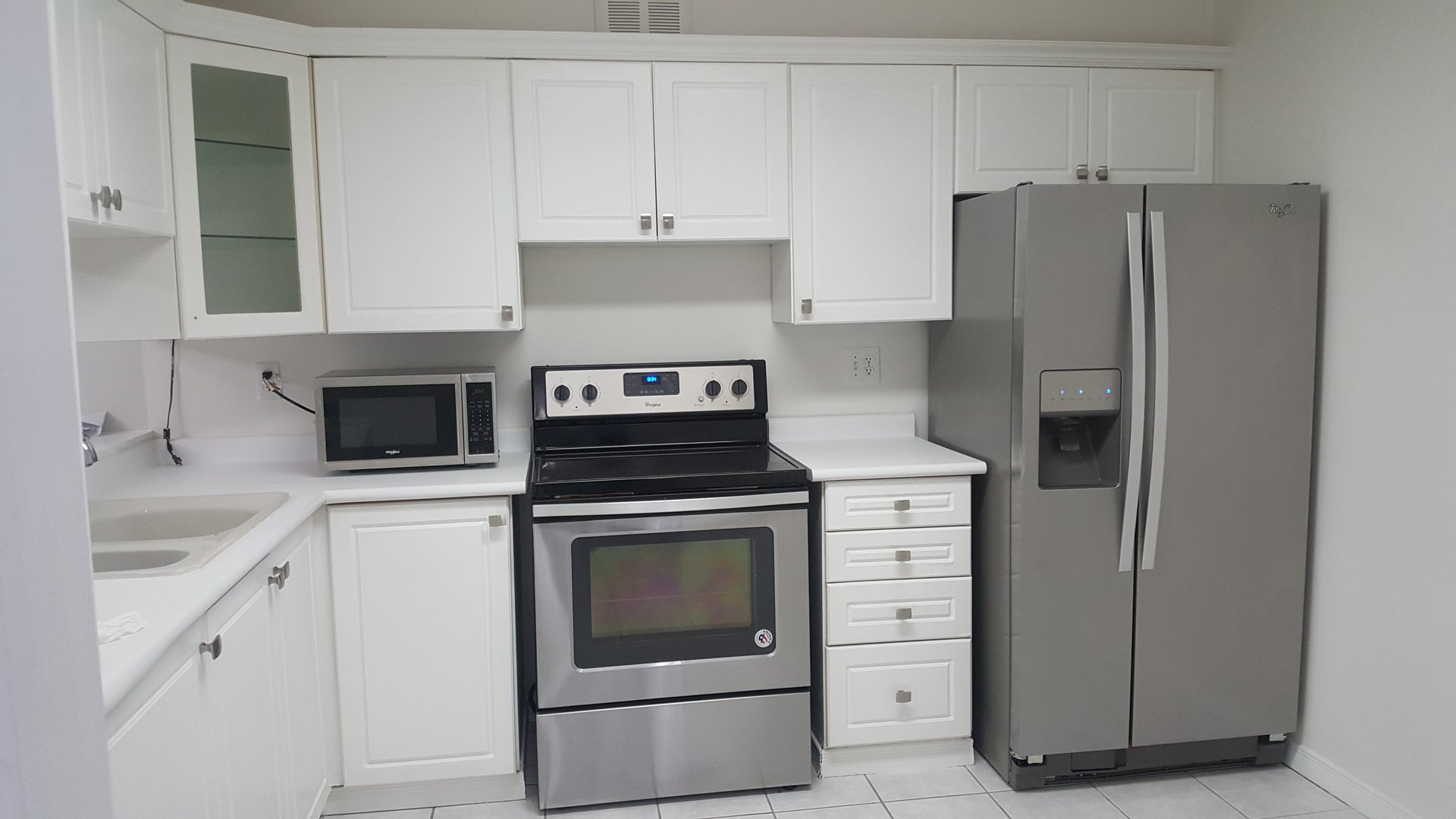 Condo for rent at 236 Albion Road, Etobicoke, ON. This is the kitchen with stainless steel and tile floor.