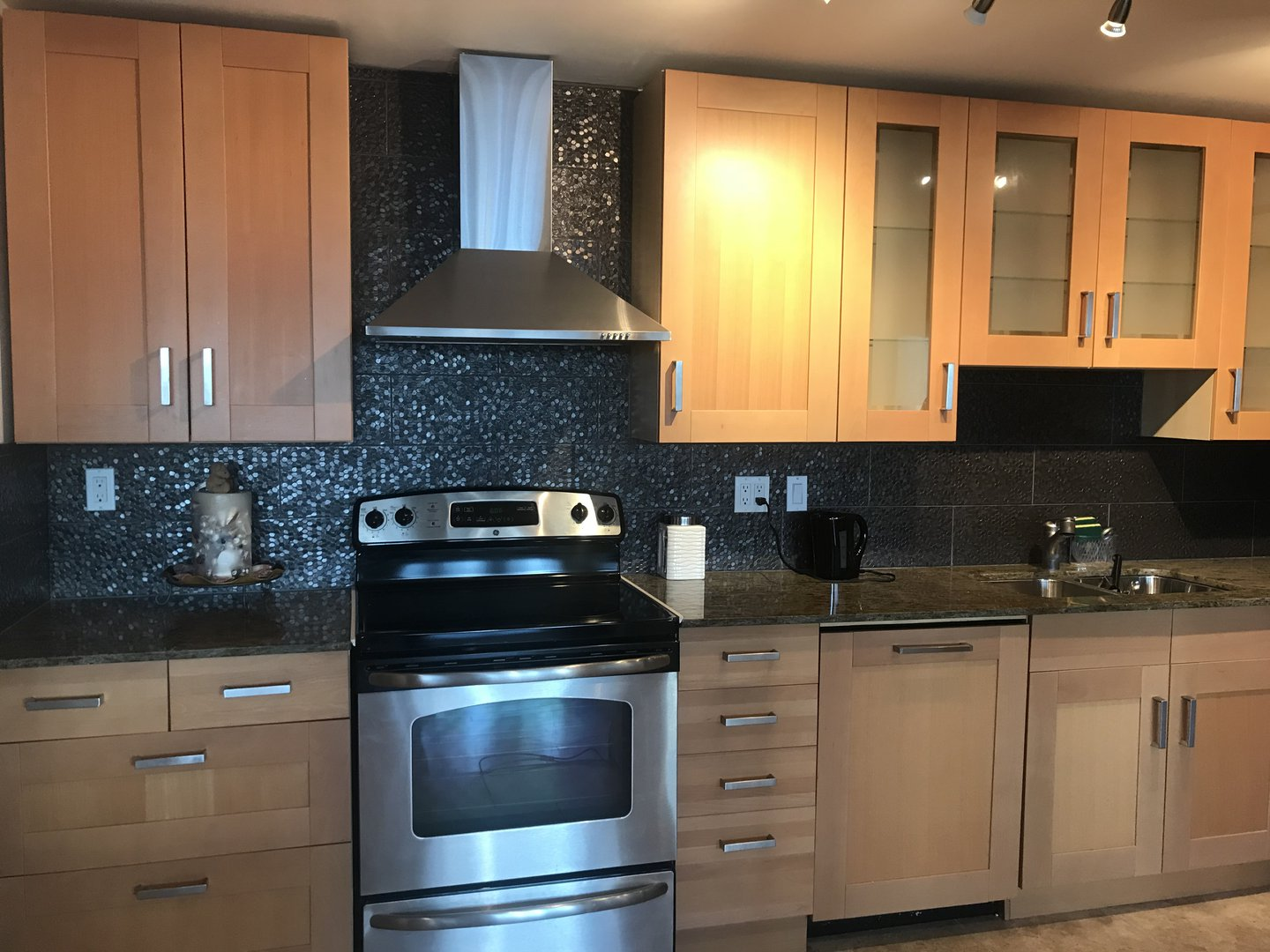 Condo for rent at 475 The West Mall, Etobicoke, ON. This is the kitchen with hardwood floor and stainless steel.