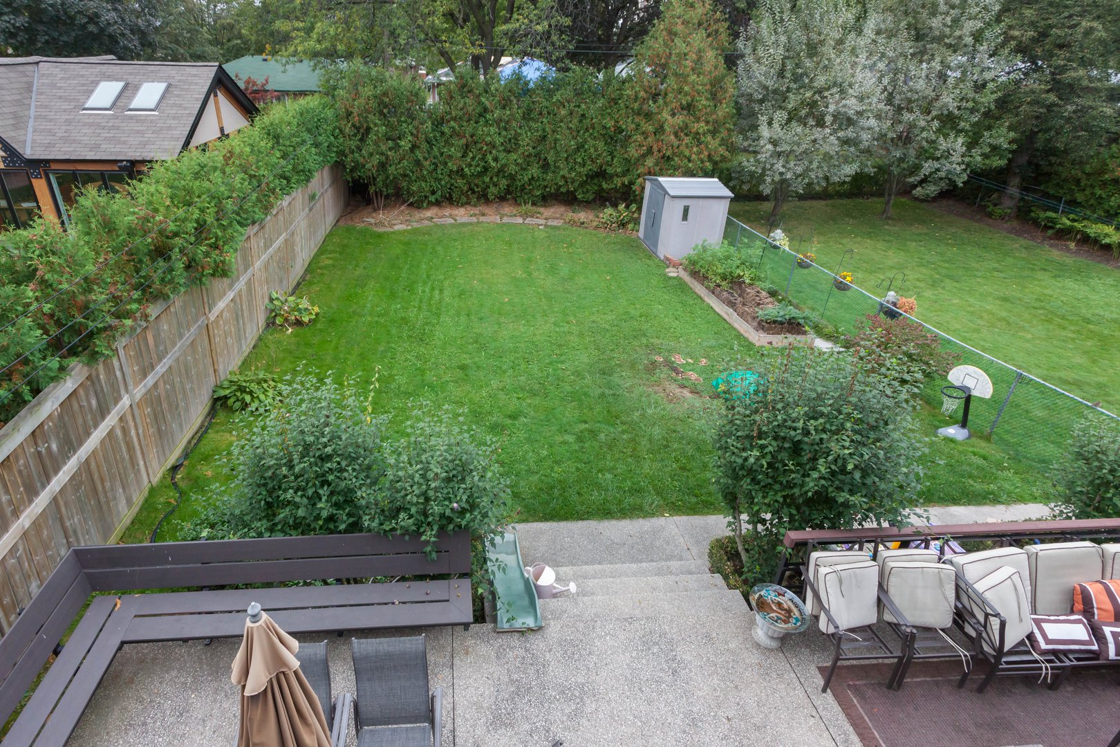 House for rent at 84 Laurel Avenue, Etobicoke, ON. This is the backyard with lawn.