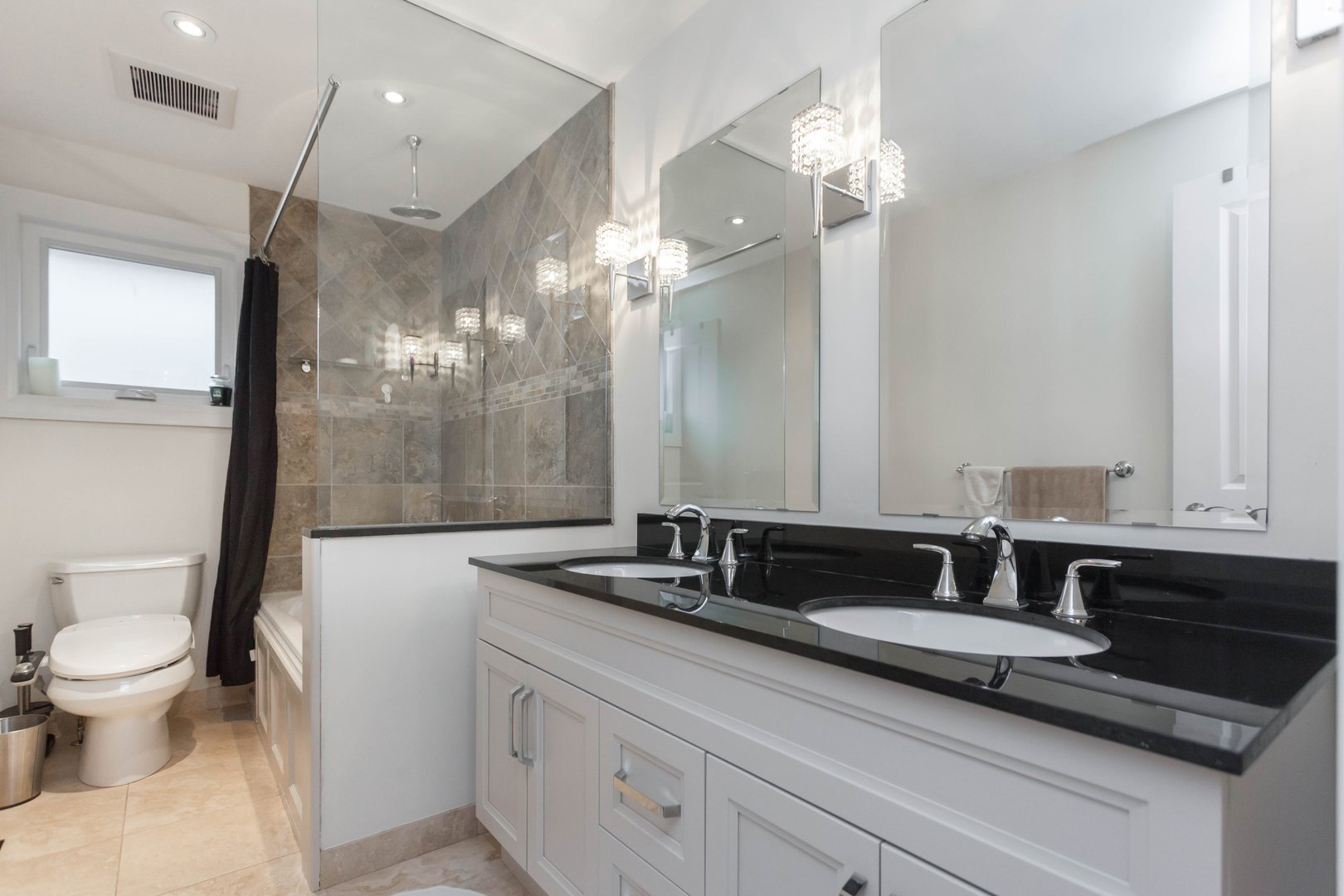 House for rent at 84 Laurel Avenue, Etobicoke, ON. This is the bathroom with natural light and tile floor.