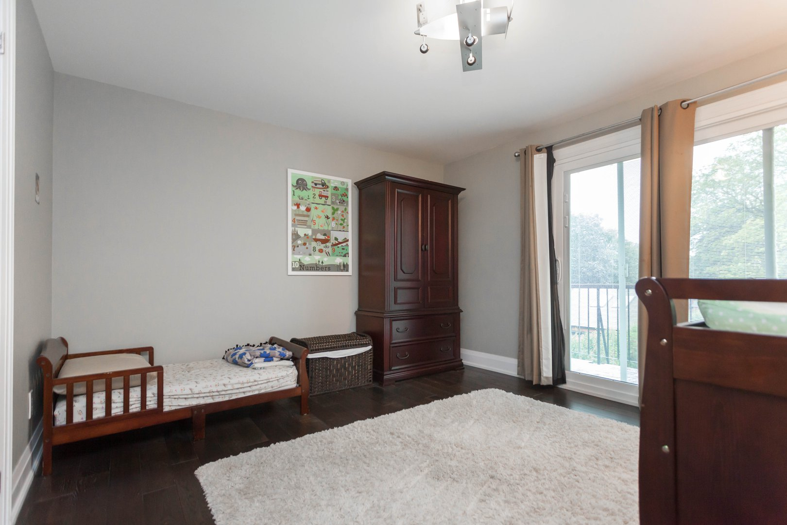 House for rent at 84 Laurel Avenue, Etobicoke, ON. This is the bedroom with natural light and hardwood floor.