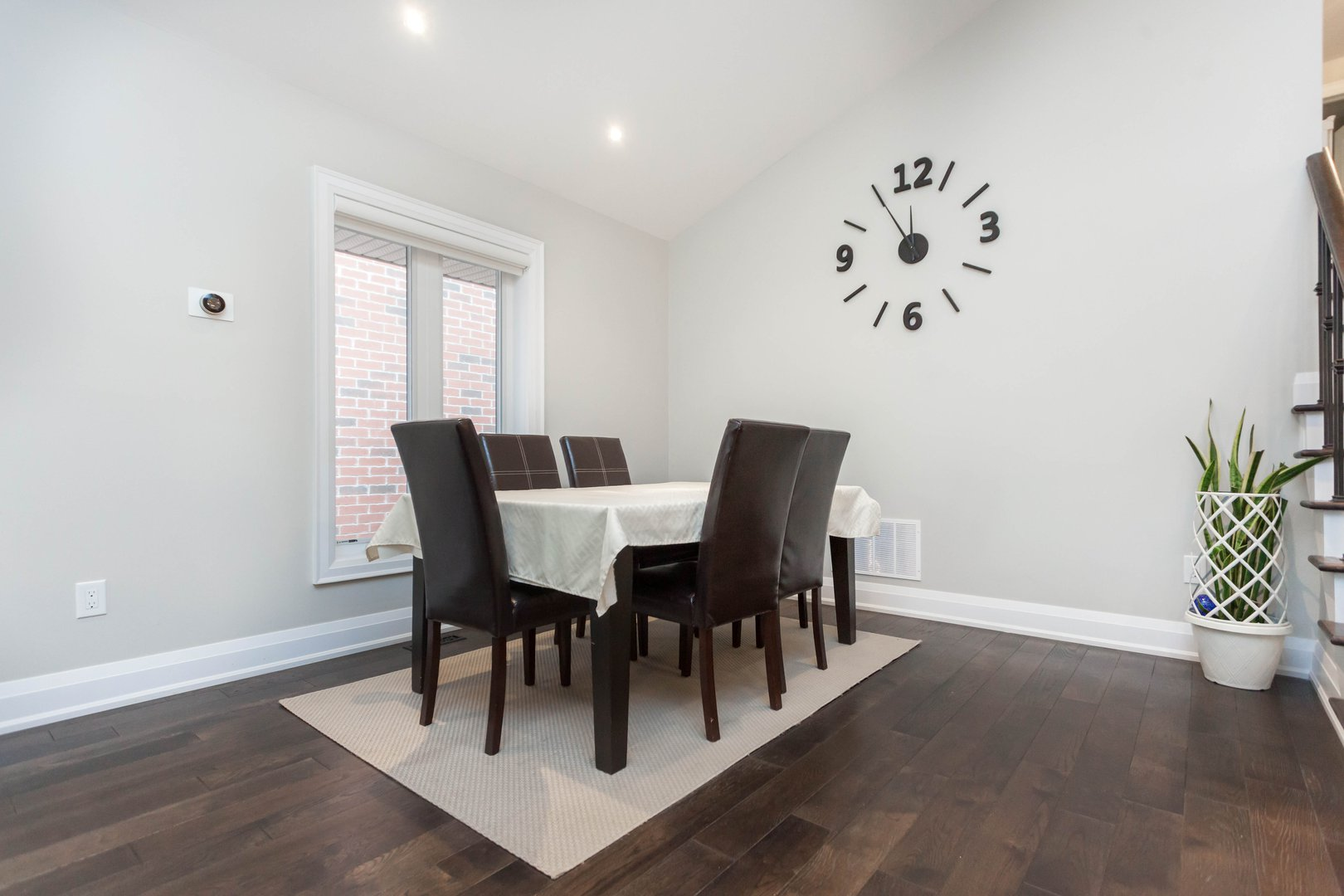 House for rent at 84 Laurel Avenue, Etobicoke, ON. This is the dining area with natural light and hardwood floor.