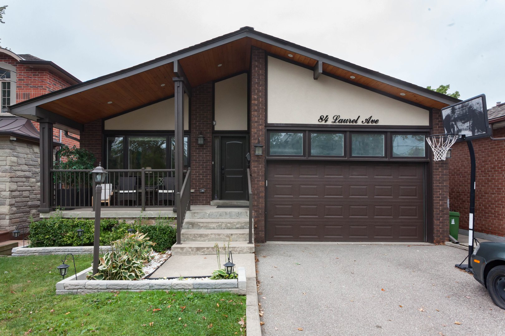 House for rent at 84 Laurel Avenue, Etobicoke, ON in contemporary style. This is the front of the house with lawn.