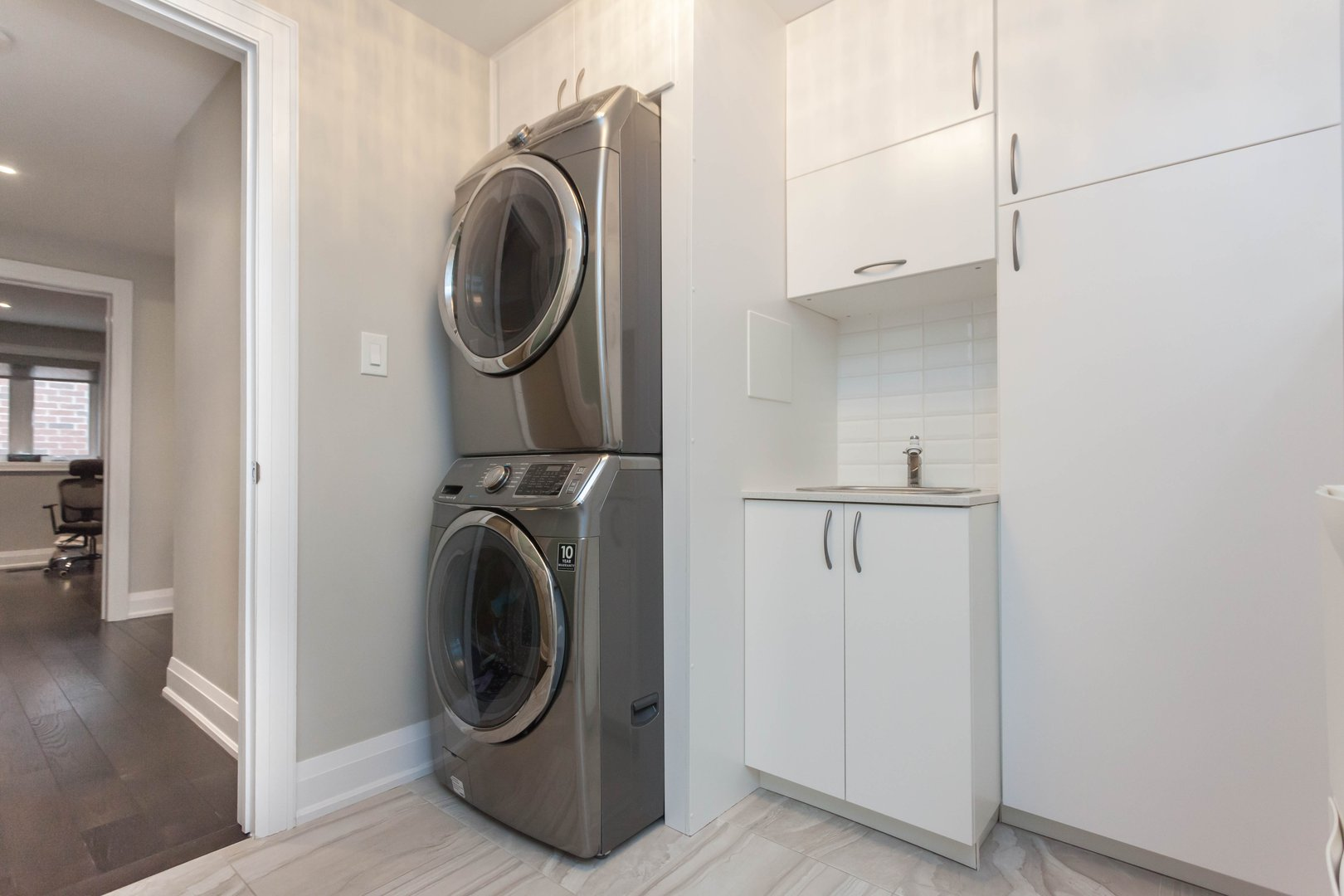 House for rent at 84 Laurel Avenue, Etobicoke, ON. This is the laundry room with natural light and hardwood floor.