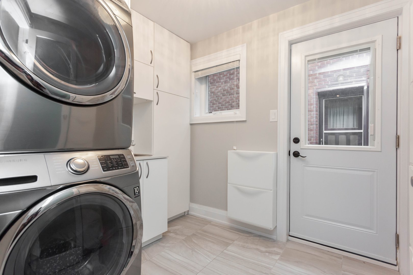 House for rent at 84 Laurel Avenue, Etobicoke, ON. This is the laundry room with tile floor.