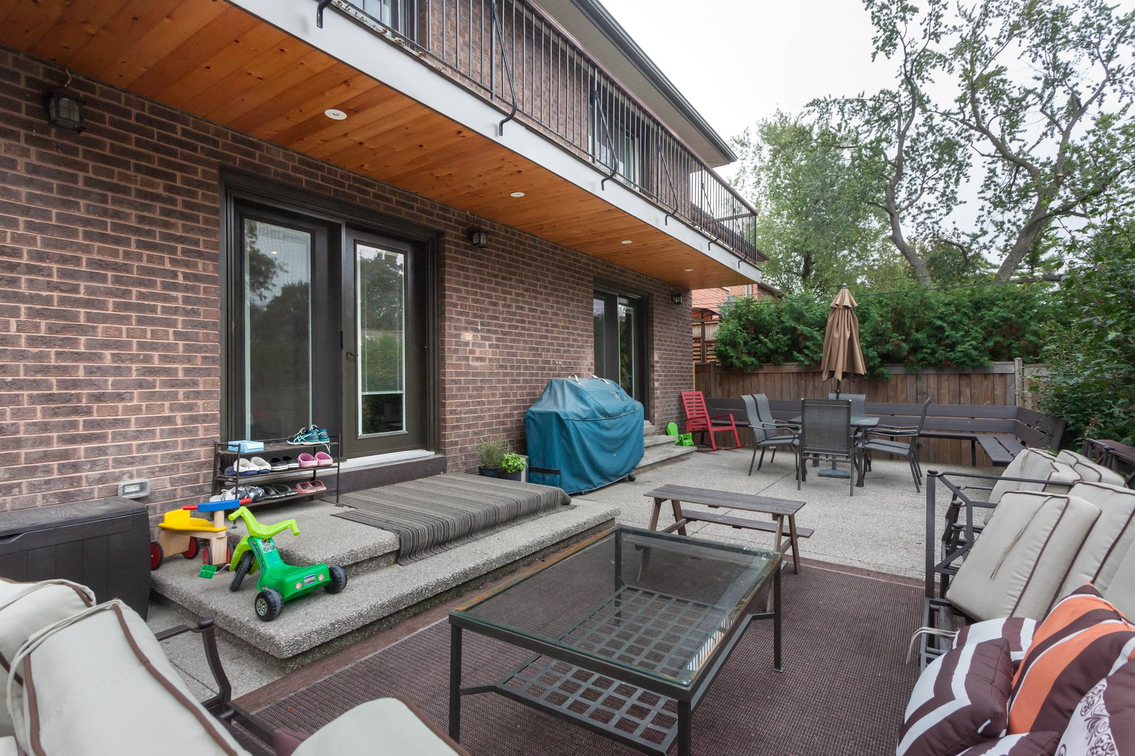 House for rent at 84 Laurel Avenue, Etobicoke, ON. This is the patio terrace with outdoor living space and french doors.