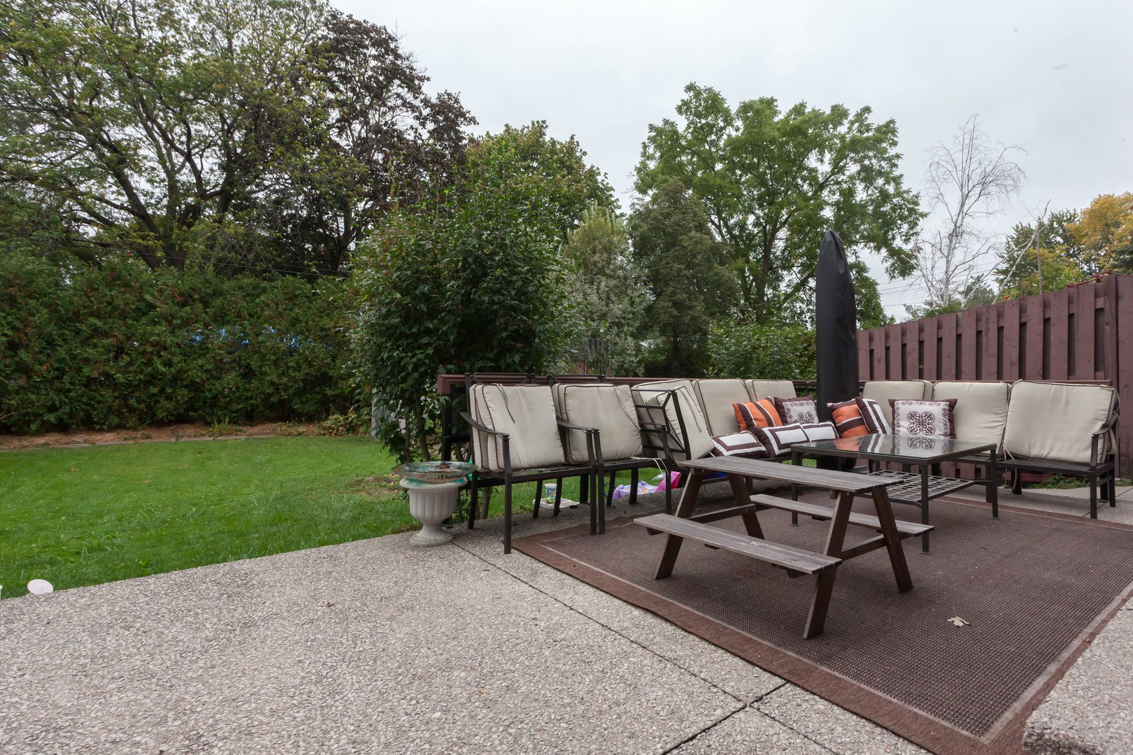 House for rent at 84 Laurel Avenue, Etobicoke, ON. This is the patio terrace with outdoor living space and lawn.