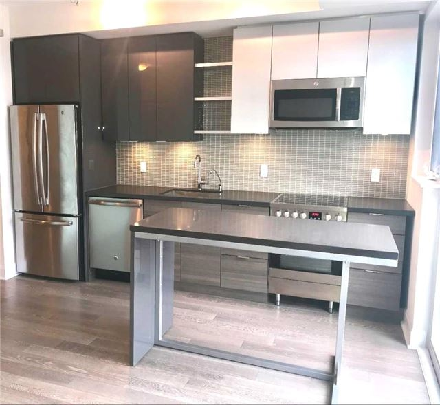 Condo for rent at 33 Shore Breeze Drive, Etobicoke, ON. This is the kitchen with hardwood floor, kitchen island and stainless steel.
