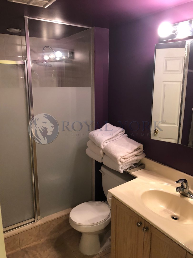 Condo for rent at 11 Michael Power Pl, Etobicoke, ON. This is the bathroom with tile floor.