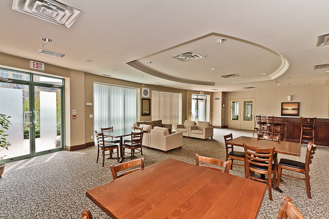 Condo for rent at 11 Michael Power Pl, Etobicoke, ON. This is the dining area with natural light and carpet.