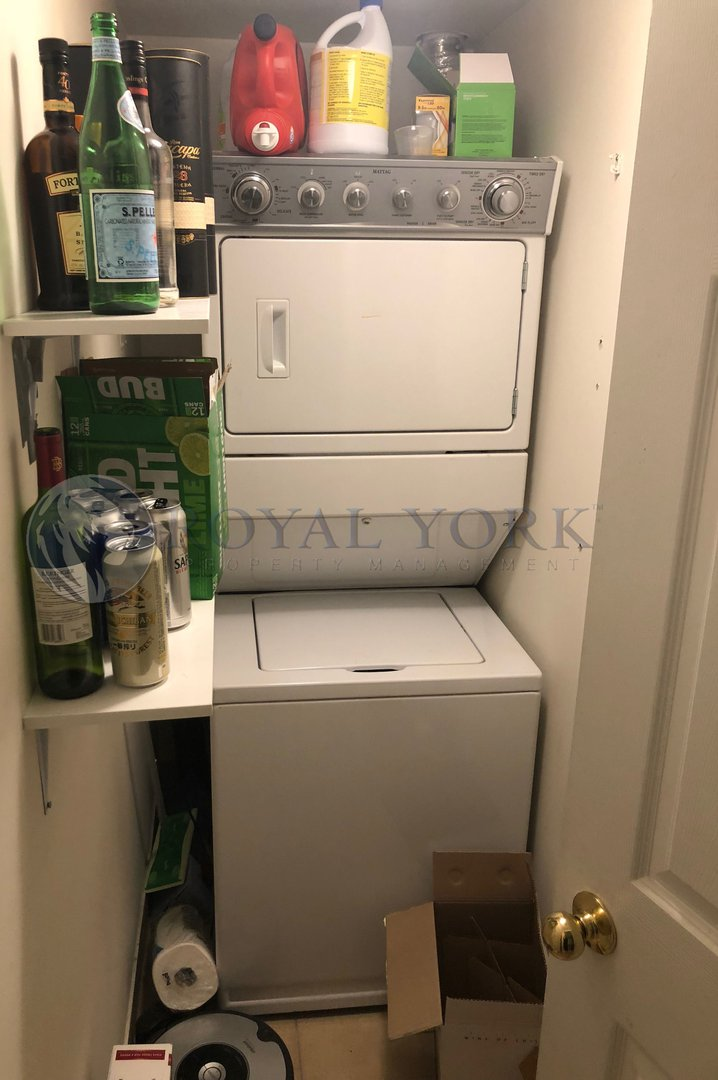 Condo for rent at 11 Michael Power Pl, Etobicoke, ON. This is the laundry room.